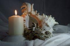 Natura morta, coperture e candela della foto fotografia stock