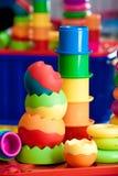 Natura morta dei dai giocattoli colorati multi Fotografie Stock Libere da Diritti