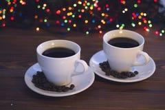 Natura morta di Natale con due tazze di caffè con i piattini Fotografia Stock Libera da Diritti