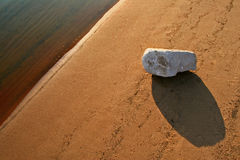 Natural abstraction - 2. Stone at an edge of water Stock Images