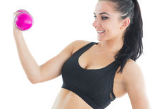 Natural active woman training with pink dumbbells Royalty Free Stock Photo