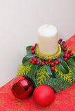 Natural advent decoration with candle and baubles Royalty Free Stock Photography