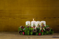 Natural advent wreath or crown with one burning white candle. Royalty Free Stock Photos