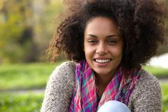 Natural african american woman smiling outside Royalty Free Stock Image