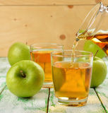 Natural apple juice Stock Photos