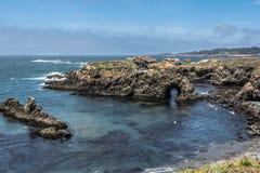 Natural arc along Mendocino coast, California. View of a natural arc along the coast of Mendocino, California Royalty Free Stock Photography