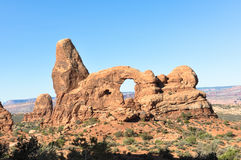Natural arc in Arches National Park, Utah. View of a natural arc in Arches National Park, Utah Royalty Free Stock Images