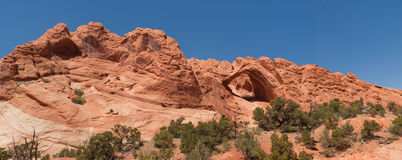 Natural arch amidst red sandstone cliff Royalty Free Stock Images