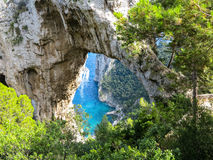 Natural Arch - Arco Naturale, Capri, Italy. Arco Naturale - natural limestone arch on the east coast of the island of Capri Stock Photography