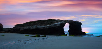 Natural arch at  As Catedrais beach in sunrise. Galicia,   Spain Stock Image