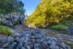 Natural arch at Bras de la Plaine at Reunion Island. Natural arch during a sunny day at Bras de la Plaine at Reunion Island Royalty Free Stock Image