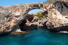 Natural arch and the grotto at Cala Antena Stock Image