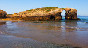 Natural arch in rocks at As Catedrais beach Royalty Free Stock Images