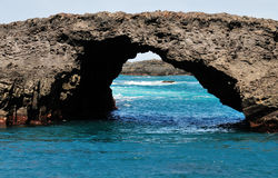 Natural Arch in Salinas. The natural volcanic arch in Salinas, deem a natural wonder of the island of Fogo, Cabo Verde Royalty Free Stock Image