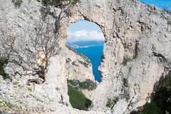 Natural arch in Sardinia Stock Images