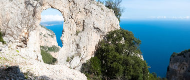 Natural arch in Sardinia Royalty Free Stock Photo