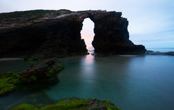 Natural arch  in twilight time Stock Photos