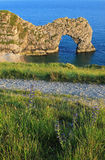 Natural archway at jurassic coast Stock Photos