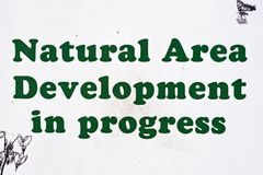 `Natural Area Development in progress` sign royalty free stock photography