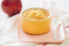 Natural baby food concept. Bowl of apple baby puree.  stock photos