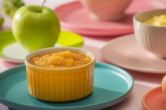 Natural baby food concept. Bowl of apple baby puree.  stock photo