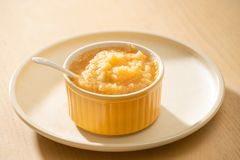 Natural baby food concept. Bowl of apple baby puree.  royalty free stock photography