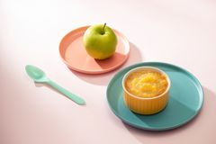 Natural baby food concept. Bowl of apple baby puree.  royalty free stock photo