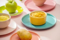 Natural baby food concept. Different types of vegetable puree on the light background.  royalty free stock photography