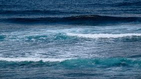 Natural background with blue tints of oceanic waves Stock Images