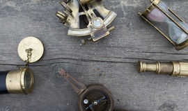 Natural background with a compass , a telescope, a sextant and a Stock Photography