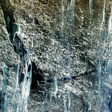 Natural background of cracked rock structure with waterfall Stock Photos