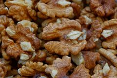 Natural texture from the grain of small brown walnuts stock images