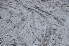 Natural texture of dirty gray snow and traces on the road royalty free stock photos