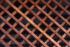 Natural background grille made of wooden slats. Element for the design of arbors, verandas and other wooden structures Stock Images