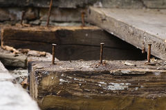 Natural background horizontal  floors  old rusty nails. Rotten, waste of deck boards and beam Stock Images