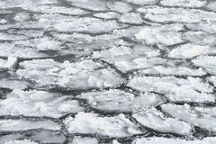 Natural background from ice and snow and water on the river Stock Photos