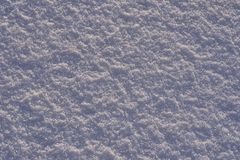 Natural background - ice surface of snow illuminated by the rays of the evening sun. The sun`s rays bouncing off the gleaming cry Stock Image