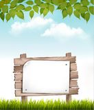 Natural background with leaves and a wooden sign. Royalty Free Stock Photos