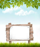 Natural background with leaves and a wooden sign. Royalty Free Stock Photo
