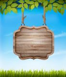 Natural background with leaves and a wooden sign. Royalty Free Stock Images