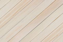 Natural background of new wooden light plank boards diagonal. Natural background of the new wooden light plank boards diagonal royalty free stock images