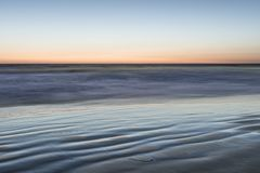 Nature fine art. Natural background. Ocean surf, long exposure. San Diego Beach, California. ,  image is an abstract illustration or painting Royalty Free Stock Photos
