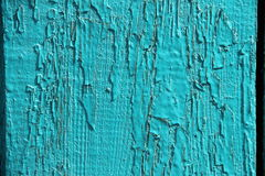 Natural background old wood texture, uneven painted blue, turquoise peeling paint Stock Images