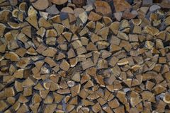 Natural background, closeup of stacked firewood. royalty free stock image