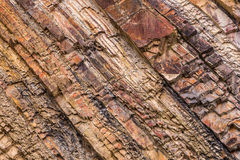Natural background - Red stripped rock texture Royalty Free Stock Images