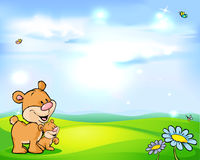 Natural background with sky, green meadow and bear Royalty Free Stock Image
