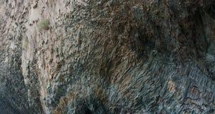 Natural background, volcanic igneous rock texture closeup. Texture of volcanic Krestovaya cliff closeup, Jasper beach, Crimea Royalty Free Stock Photography