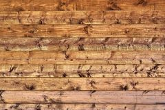 Natural background - a wall of wooden boards with moraine surface. Brown shad Stock Photo