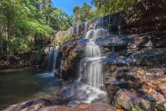 Natural background of waterfall cascade in National Park of Thai. Land Stock Photos