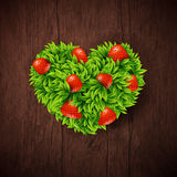 Natural background with wooden board and heart made of leaves an Royalty Free Stock Photo